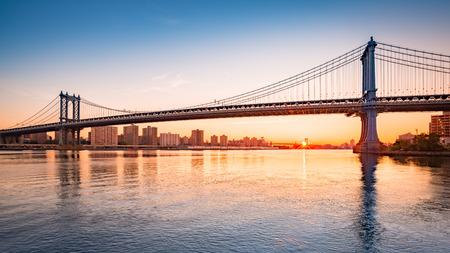 city by night: Manhattan Bridge at sunrise, viewed from Brooklyn Bridge park