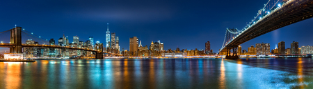 Night panorama with the downtown New York City skyline and the Two Bridges: Brooklyn Bridge and Manhattan Bridge, viewed from Brooklyn Bridge Park