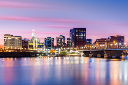 hartford: Hartford skyline and Founders Bridge under a purple twilight. Hartford is the capital of Connecticut. Stock Photo