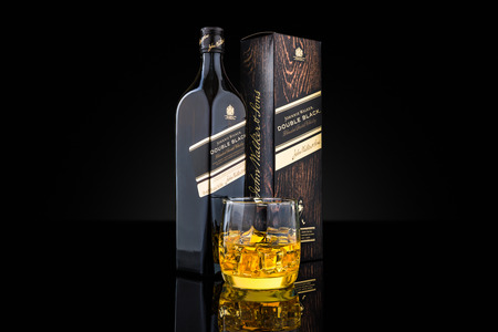 scotch whisky: Bottle, box and glass of Johnnie Walker Double Black blended scotch whisky. Johnnie Walker is the most widely distributed brand of blended Scotch whisky in the world.