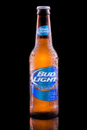 Bottle of Bud Light beer. Bud Light, distributed by Anheuser-Bush Inbev,  is the top selling beer in United States.