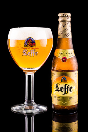 marketed: Leffe beer bottle and glass. Leffe is a beer brand owned by InBev Belgium marketed as Abbey beer.