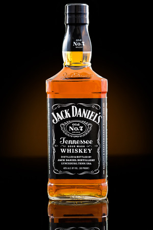 daniels: Jack Daniels whisky bottle. Jack Daniels is a brand of sour mash Tennessee whiskey that is the highest selling American whiskey in the world