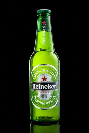 pilsner beer glass: USA imported Heineken beer bottle. Heineken is a popular Dutch pale lager beer produced by the Dutch brewing company Heineken International. Editorial