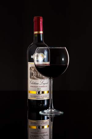 cabernet sauvignon: Glass and Bottle of 2011 Chateau Lagnet wine. Chateau Lagnet is a red wine from Bordeaux, France made of 80% Merlot and 20% Cabernet Sauvignon. Editorial