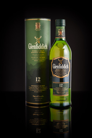 12 year old: Photo of a 12 year old Glenfiddich single malt scotch whisky. Glenfiddich means Valley of the Deer in Gaelic, reason for the stag symbol on the bottle. Editorial