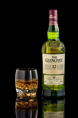 12 year old: Glass and bottle of Glenlivet single malt scotch whisky. The Glenlivet brand is the biggest selling single malt whisky in the USA and the 2nd biggest globally.