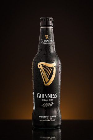 draught: Photo of the new USA imported Draught Guinness bottle. Guinness is a popular Irish stout and one of the most successful beer brands worldwide.