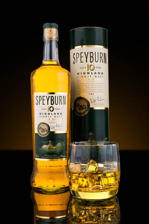 scotch whisky: Bottle, box and glass of Speyburn single malt scotch whisky. Speyburn 10 year old single malt is matured in a combination of American Oak ex-bourbon and ex-sherry casks
