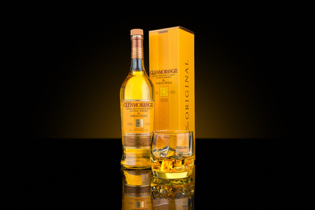 categorized: Bottle, box and glass of Glenmorangie single malt whisky. Glenmorangie is categorized as a Highland distillery and boasts the tallest stills in Scotland. Editorial