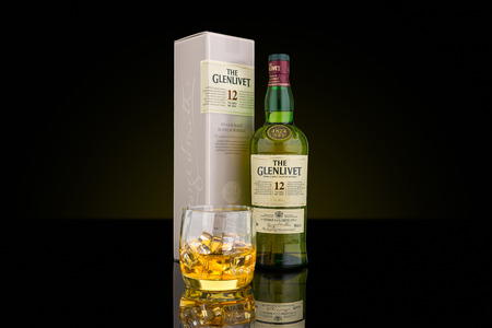 12 year old: Bottle, box and glass of The Glenlivet single malt whisky. The Glenlivet brand is the biggest selling single malt whisky in the USA and the 2nd biggest globally. Editorial
