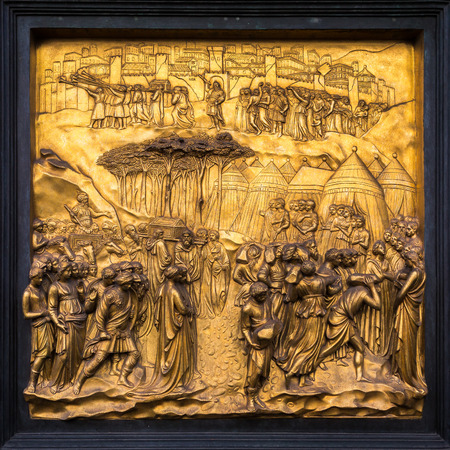 relief: Outdoor detail of Florence Baptistery -  Gates of Paradise - Fall of Jericho. Stock Photo