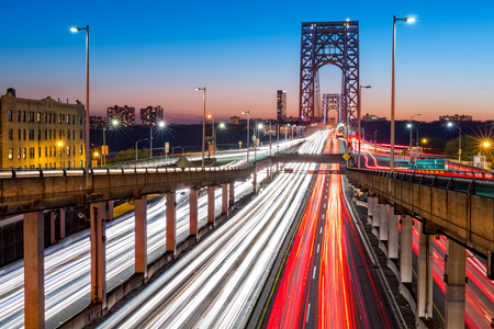 city road: Rush hour traffic with light trails on George Washington Bridge, in New York City