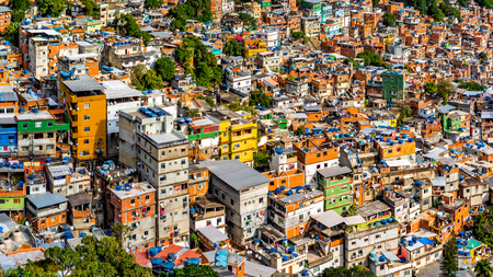 societies: Aerial view of Rios Rocinha favela, on a sunny afternoon. Stock Photo