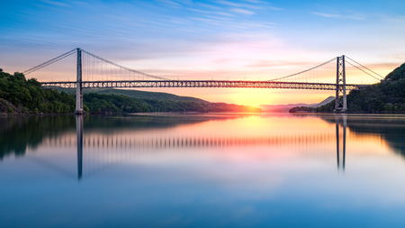 sunrise mountain: Bear Mountain Bridge at sunrise (long exposure). Bear Mountain Bridge is a toll suspension bridge in New York State, carrying U.S. Highways 202 and 6 across the Hudson River
