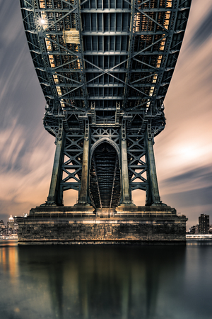 manhattan bridge: Moody symmetrical perspective under Manhattan Bridge at night.