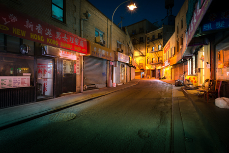 shootings: NEW YORK - JUNE 18, 2016: Doyers Street by night, in NYC Chinatown. The bend became known as the Bloody Angle because of numerous gang shootings.