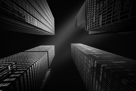 convergence: Architectural fine-art black and white photograph with four New York skyscrapers converging towards the sky