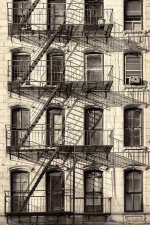 old new: Typical old New York City building with fire escape ladders