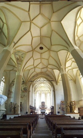 evangelical: Vertical panorama of the Church on the Hill interior. The Church on the Hill (Biserica din Deal) is a medieval evangelical church dedicated to St. Nicholas, located in Sighisoara, Romania