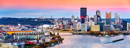 allegheny: Pittsburgh, Pennsylvania skyline at sunset and the famous baseball stadium across Allegheny river Stock Photo