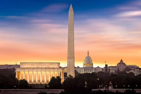 lincoln memorial: New Dawn over Washington - with 3 iconic monuments illuminated at sunrise: Lincoln Memorial, Washington Monument and the Capitol Building. Stock Photo