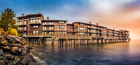 Panorama with stilt houses in West Seattle neighborhood at sunset`` Stock Photo