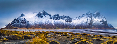 Vestrahorn mountain range and Stokksnes beach panorama, near Hofn, Iceland. An unidentifiable photographer captures the scenery.