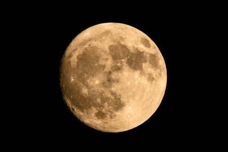 Closeup of a large shining full moon against dark background Banque d'images - 100069727