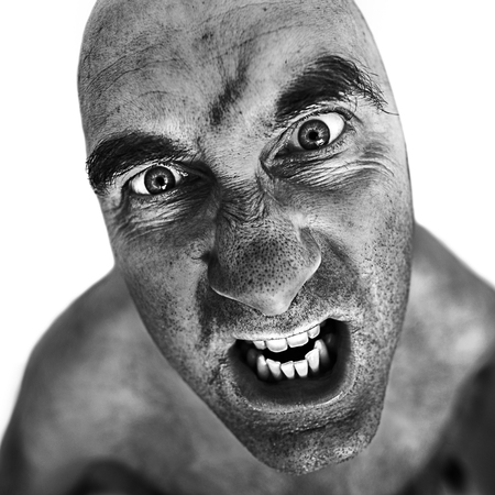Black and white portrait of mad man processed using the dragan effect. Stock Photo