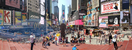 NEW YORK - MAY 2, 2018: Panoramic view of Times Square. Times Square is a major commercial intersection, tourist destination, entertainment center and neighborhood in the Midtown Manhattan