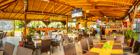 Indoor panorama of rustic restaurant and bar in a Black Sea resort. Banque d'images - 108371784