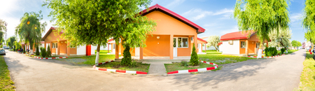 Panorama with Row of units in an affordable motel and camping on a romanian Black Sea resort Фото со стока