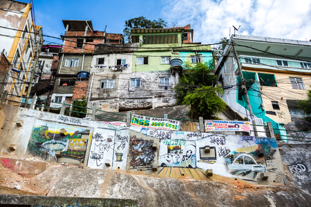 RIO DE JANEIRO - AUGUST 22 2015: Garbage collection place in Rochina Favela. Rocinha is the largest favela in Brazil. Graffiti decorates crammed hillside houses.