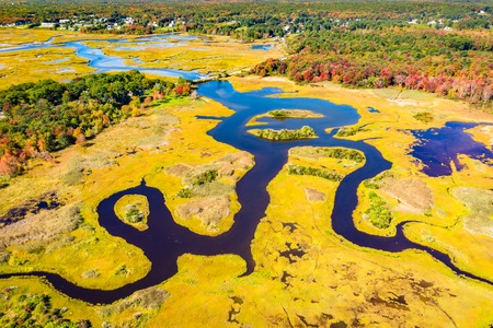 Aerial view of Little River estuary in Wells Estuarine Reserve, Maine Фото со стока