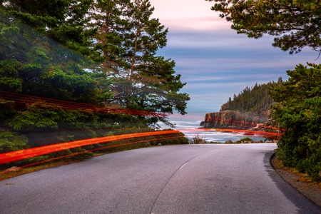 Park Loop road at dusk, with light trails, in Acadia National Park, Maine Banque d'images - 115066758