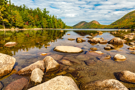 Jordan Pond in Acadia Nantional Park, Maine with calm and transparent waters, on a sunny autumn day.