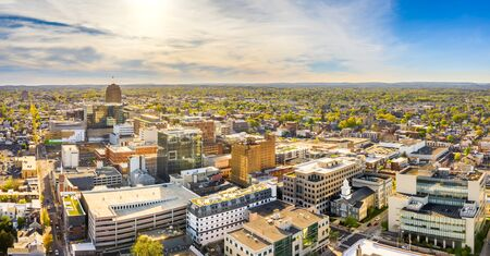 Aerial panorama of Allentown, Pennsylvania skyline on late sunny afternoon. Allentown is Pennsylvanias third most populous city. Banco de Imagens - 130798364