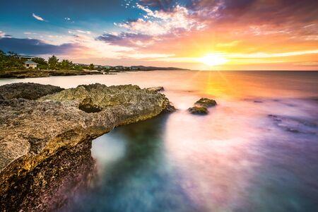 Long exposure sunset over a tropical rocky beach in Jamaica Zdjęcie Seryjne