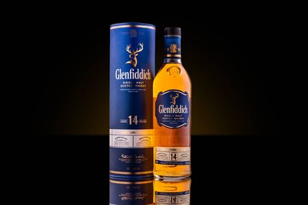 ROCKAWAY, NJ - FEBRUARY 29, 2020: Bottle and case of a 14 years old Glenfiddich single malt scotch whisky. Glenfiddich means 'Valley of the Deer' in Gaelic, reason for the stag symbol on the bottle. Editorial