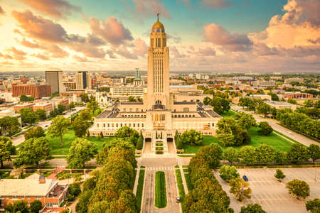Lincoln skyline and Nebraska State Capitol. The Nebraska State Capitol is the seat of government for the U.S. state of Nebraska and is located in downtown Lincoln.