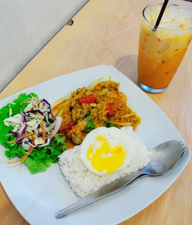 shrimp with curry sauce and fried egg photo