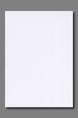 White  paper on gray background isolated