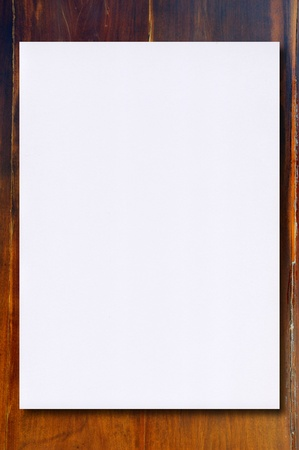 White paper on Wood Background Stock Photo