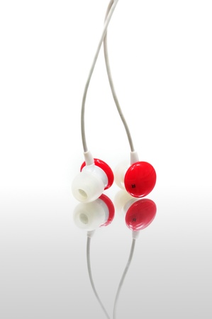 Red earphone Isolaed on white background photo