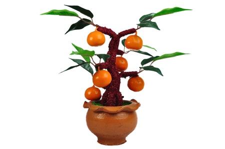 Fake orange tree isolated on white background photo