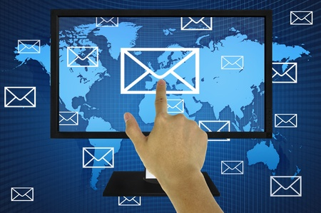 Hand pressing world wide mail  on the LED monitor