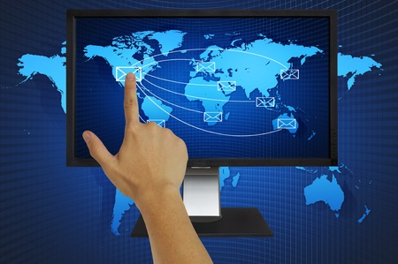 Hand pressing world wide mail on computer LCD Monitor