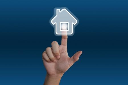 Hand pressing home symbol