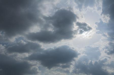 Rain Cloud consume the blue sky. Stock Photo